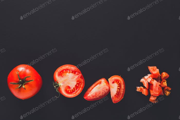 Stages of cutting tomato on black background
