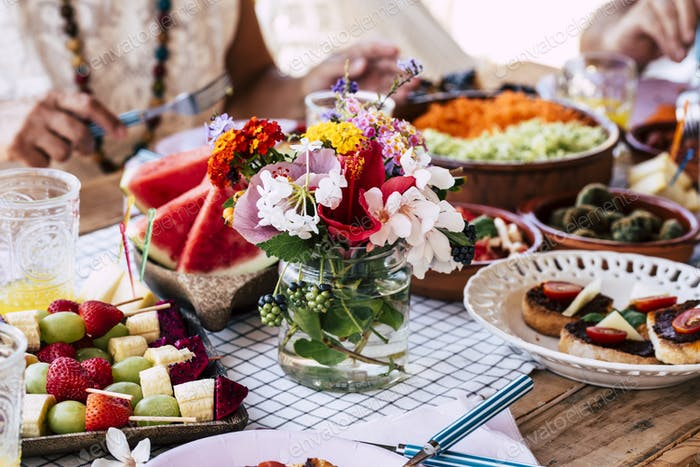 Close up of table full of food and flower