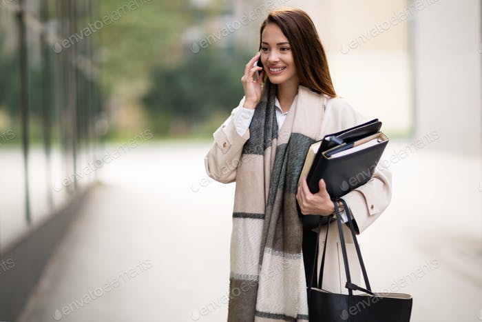 Businesswoman carrying folders to work
