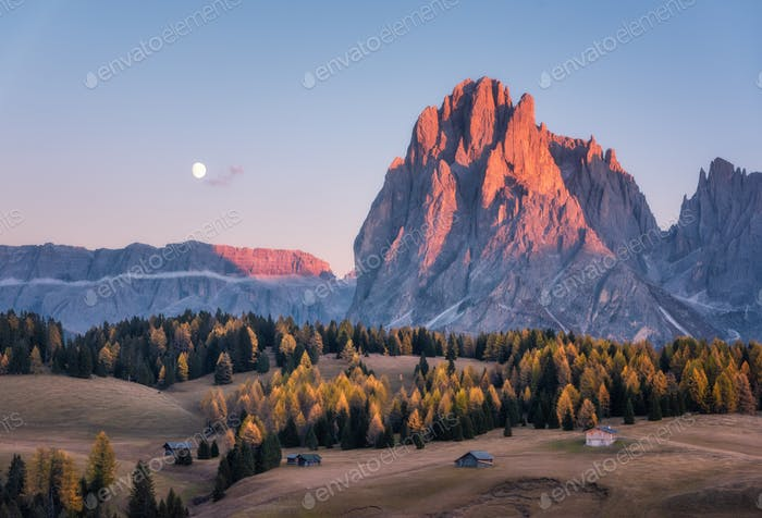 Beautiful mountains with lighted peaks at sunset in autumn