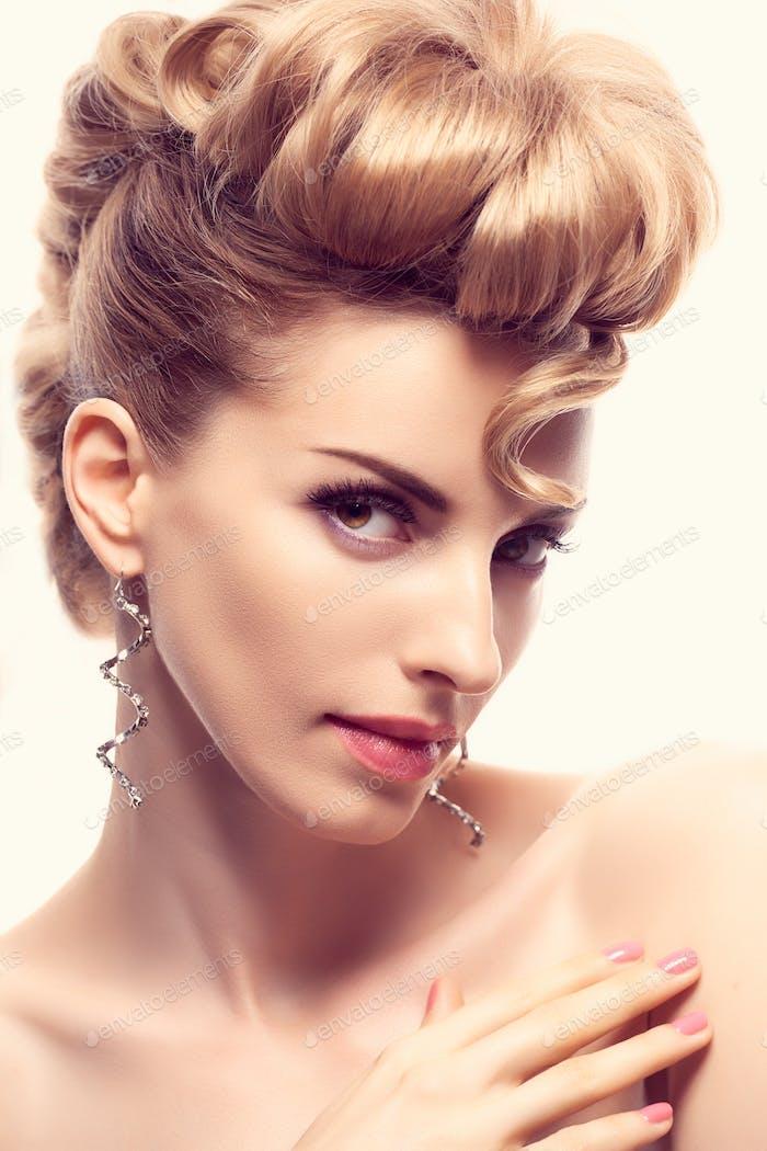 Fashion mohawk hairstyle, makeup. Creative unusual