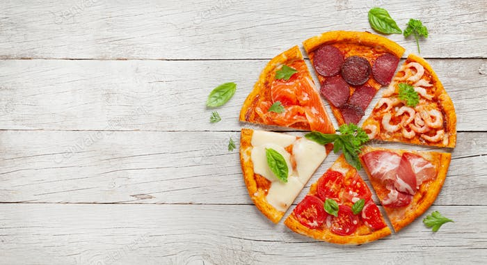 Tasty slices of different pizza