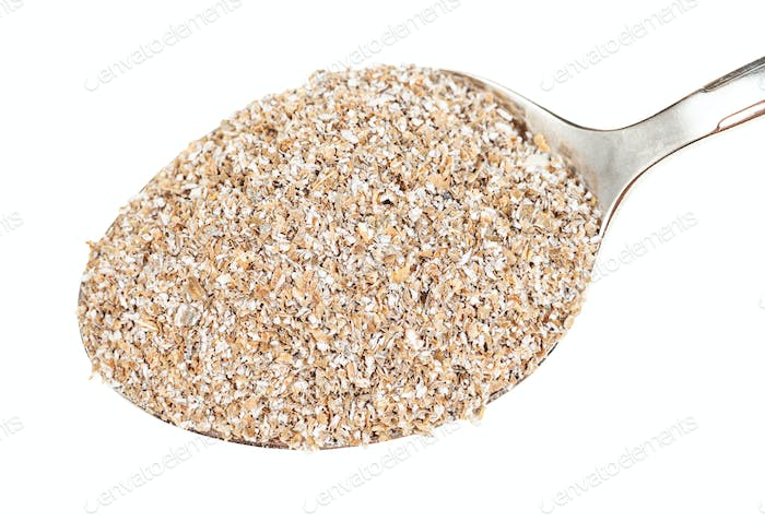 top view of spoon with rye bran close-up