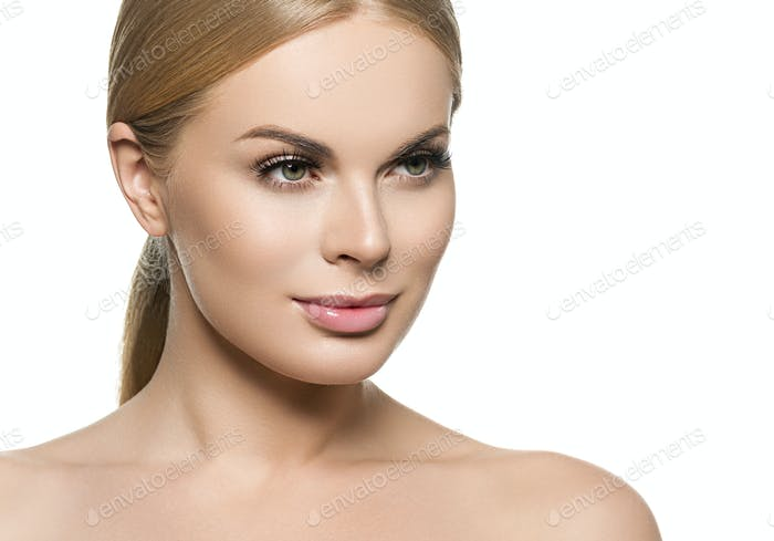 Beautiful woman face close up long curly blonde hair studio on beige