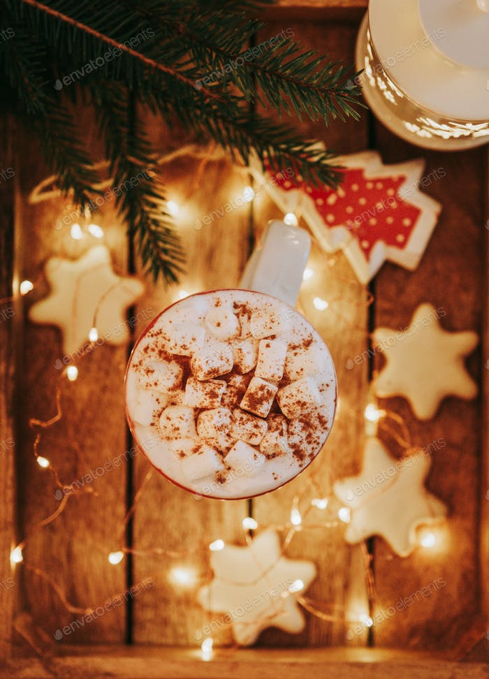 Close up of christmas white mug with hot cocoa, tea or coffee and marshmallow.