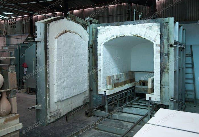 Clay oven with open door in pottery.