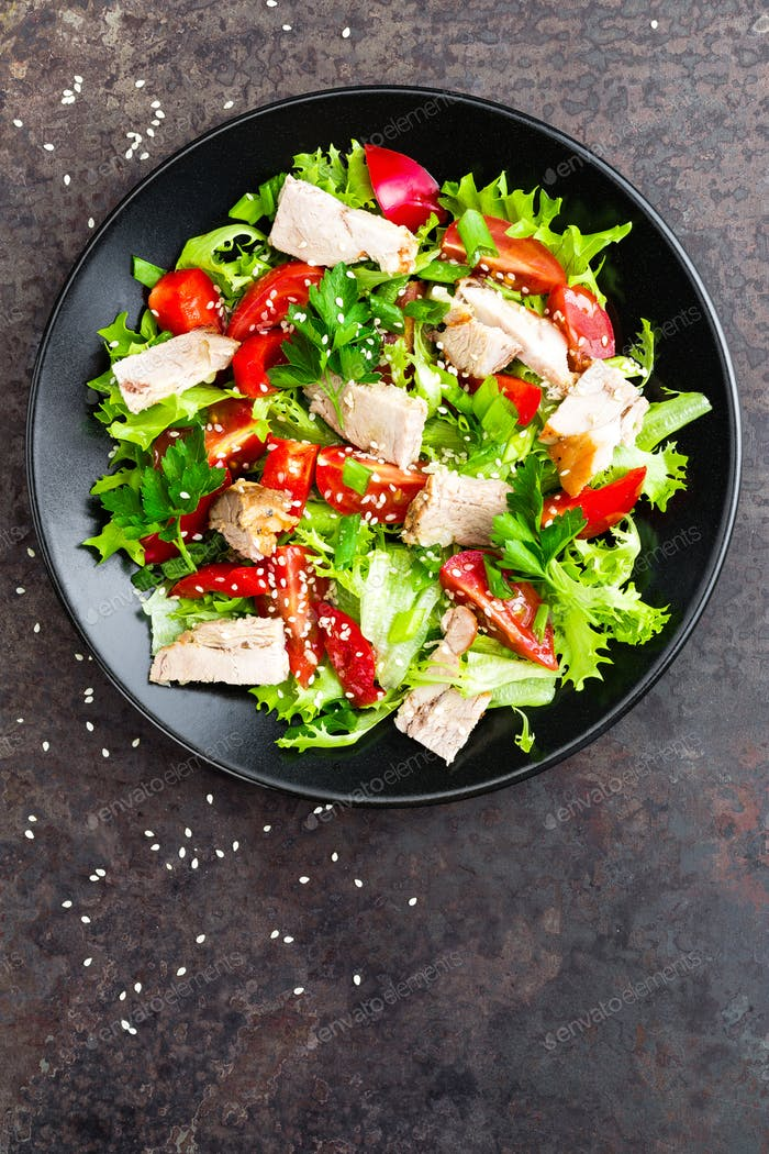 Salad with meat. Fresh vegetable salad with baked meat. Meat salad with fresh vegetables on plate