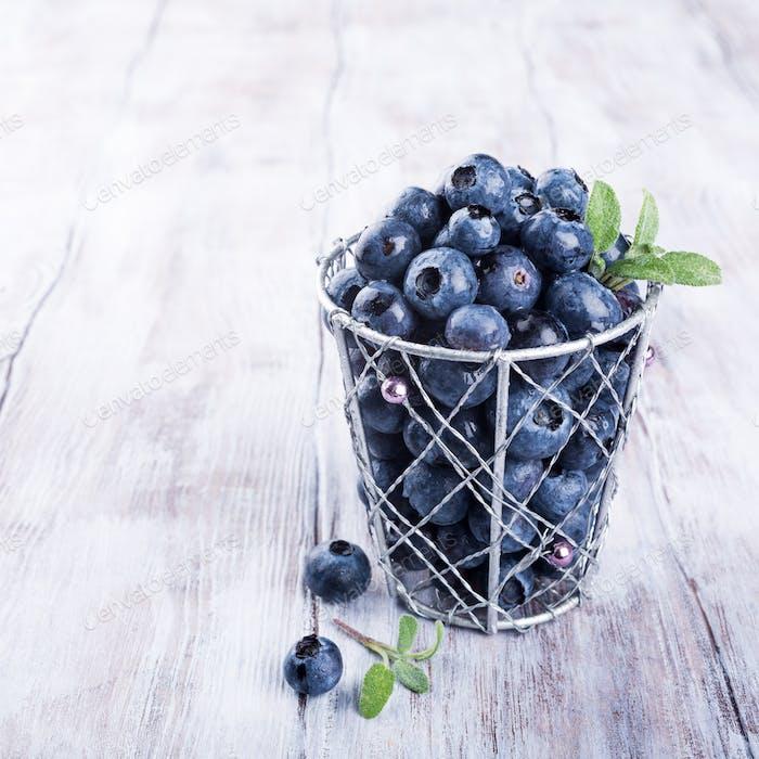 Blueberries in metal cup