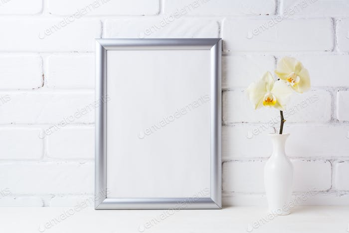 Silver frame mockup with soft yellow orchid in vase