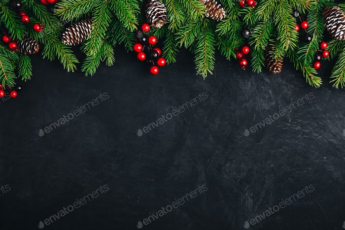Christmas tree decoration background with fir cones and red berries.