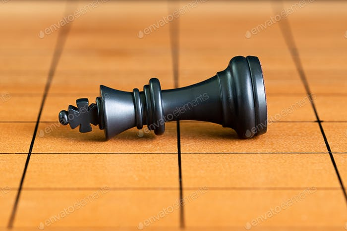 Chess pieces on a wood chessboard