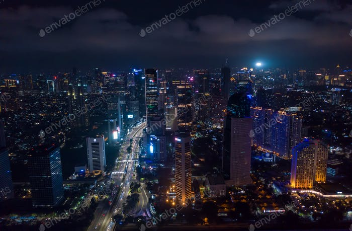 Modern metropolitan city center with skyscrapers at night City lights in Jakarta, Indonesia