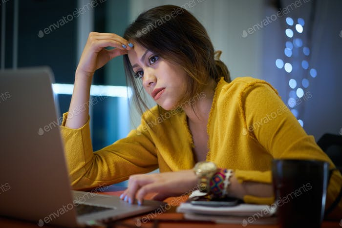 Pensive Girl College Student Studying At Night
