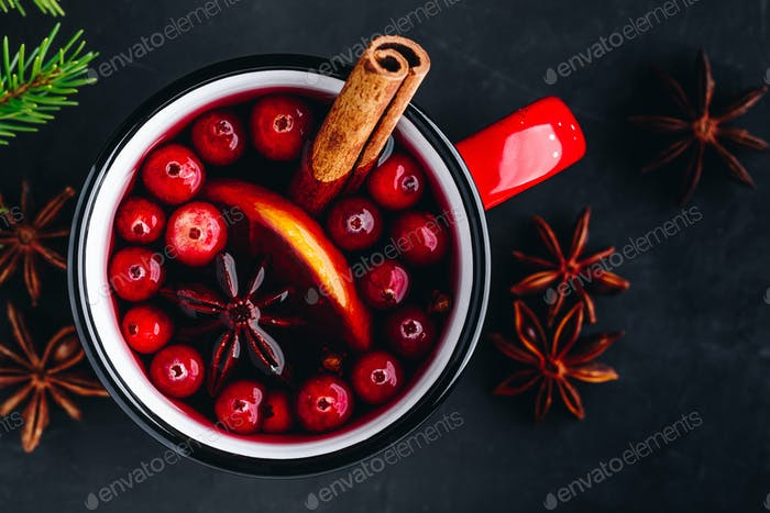 Traditional Christmas Mulled Wine drink with cranberries, orange slices and spices
