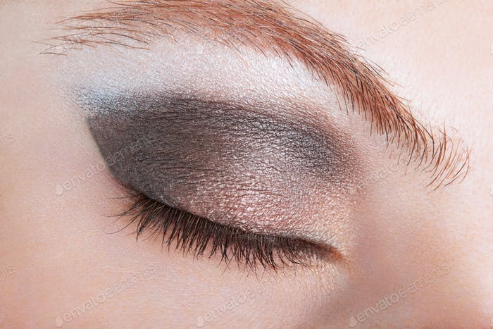 Woman eye with bronze smokey make up