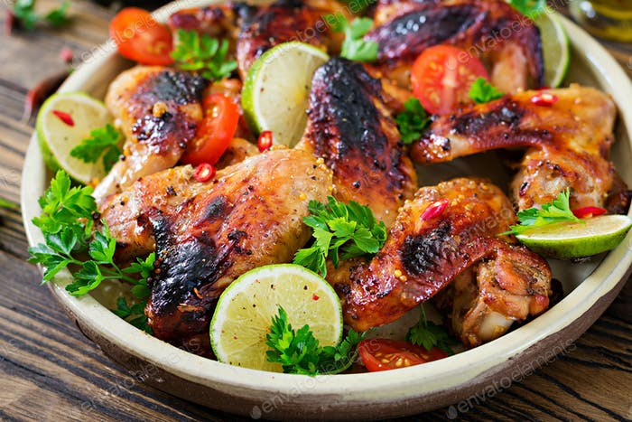Chicken wings of barbecue in sweetly sour sauce. Picnic. Summer menu. Tasty food