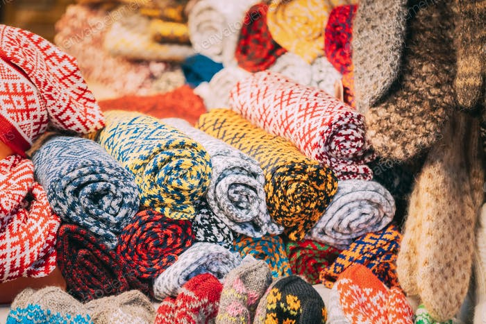 Various Colorful Knitted Traditional European Warm Clothes - Scarfs At Winter Christmas Market