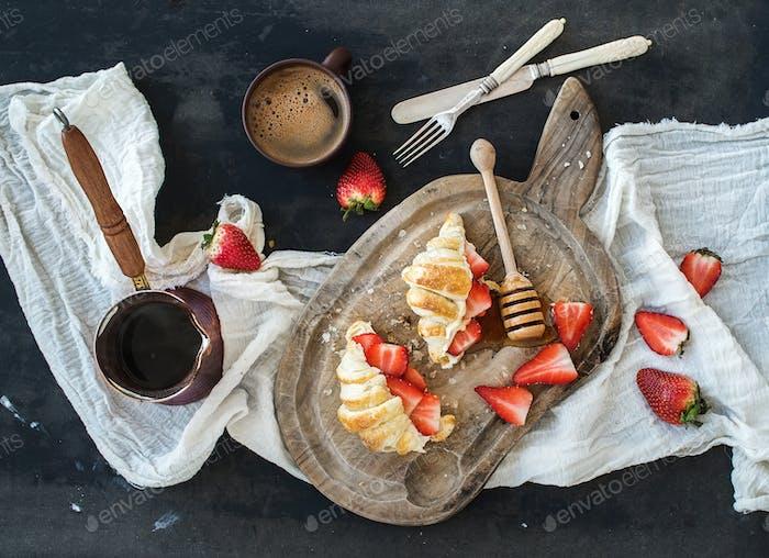Breakfast set. Freshly baked croissants with strawberries