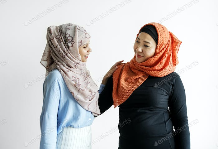 Two of islamic friends talking and greeting
