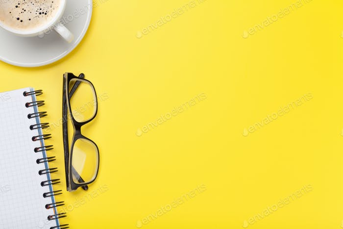 Office yellow workplace backdrop with coffee cup, supplies