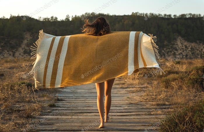 Beautiful woman wrapped in a wool towel