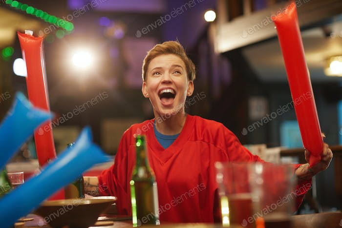 Excited fan in sport bar