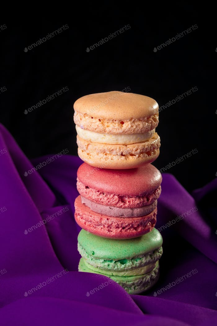 Tower of three colorful macaroons