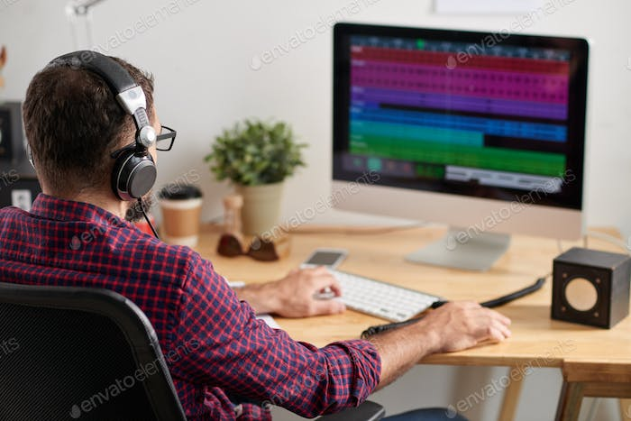 Man working at sound studio