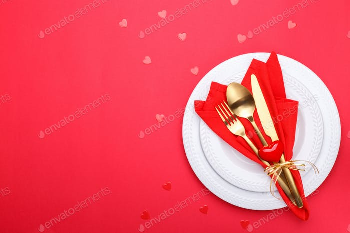 Romantic table setting with gold cutlery