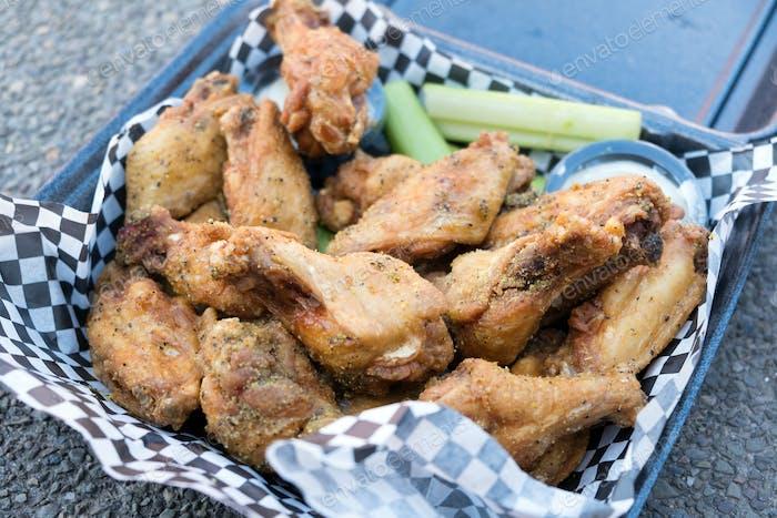 Black pepper Buffalo wings chicken in basket