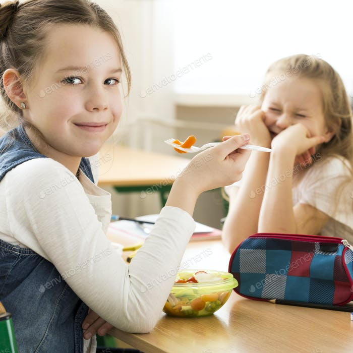Girls eating lunch in primary school