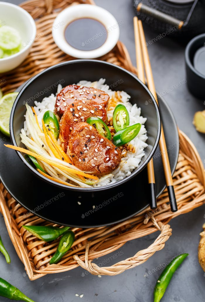 Asian food - roast meat with rice and vegetables.
