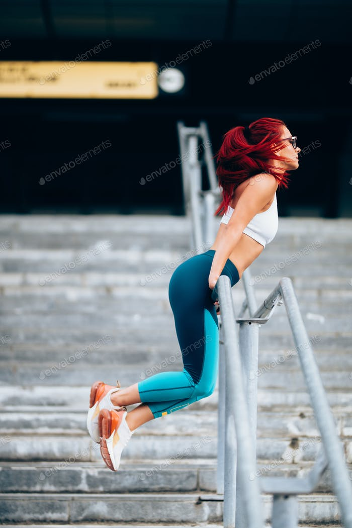 fitness woman stretching outdoors and training, doing exercises. Training and working out