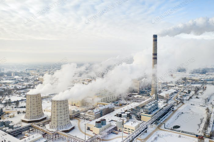 Thermal power plant in winter in the city of Minsk. Smoke is coming from the big Chimneys