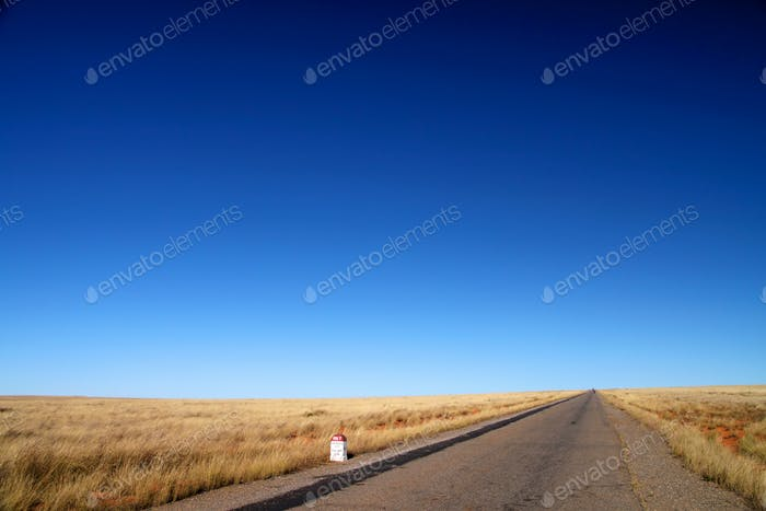 Road through empty grassland