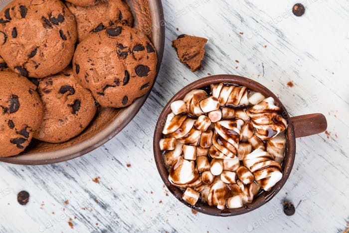 Hot chocolate with marshmallow and chocolate cookies. Flat lay.