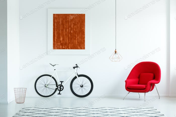 Real photo of a bike with black tires, red armchair, painting an