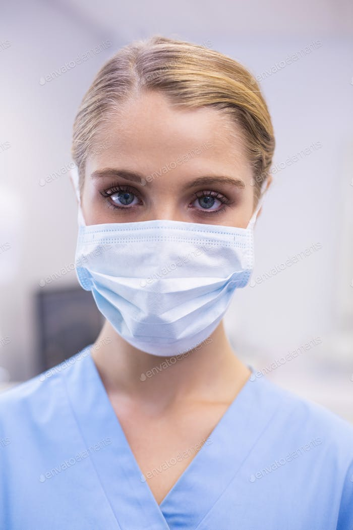 Portrait of female nurse wearing surgical mask