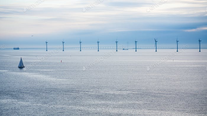 panorama with offshore wind farm in morning