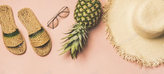 Variety of summer apparel items and fresh pinapple, wide composition
