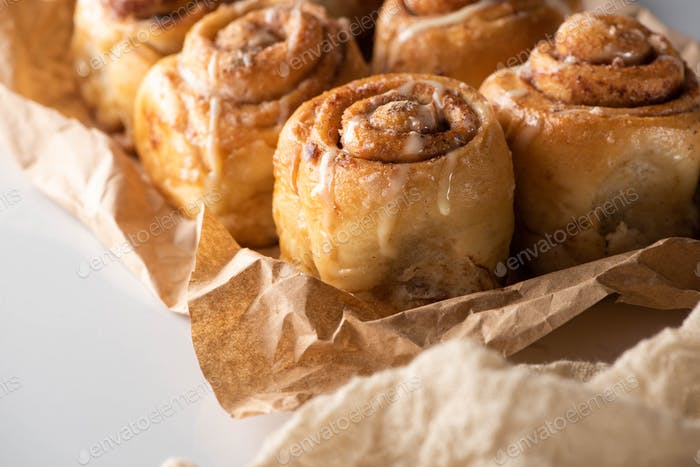 Close up View of Fresh Delicious Homemade Cinnamon Rolls on Parchment Paper
