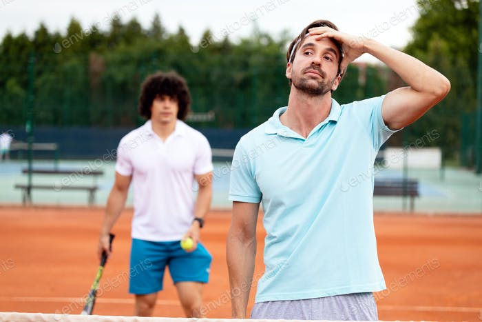 Disappointed tennis player playing tennis on court