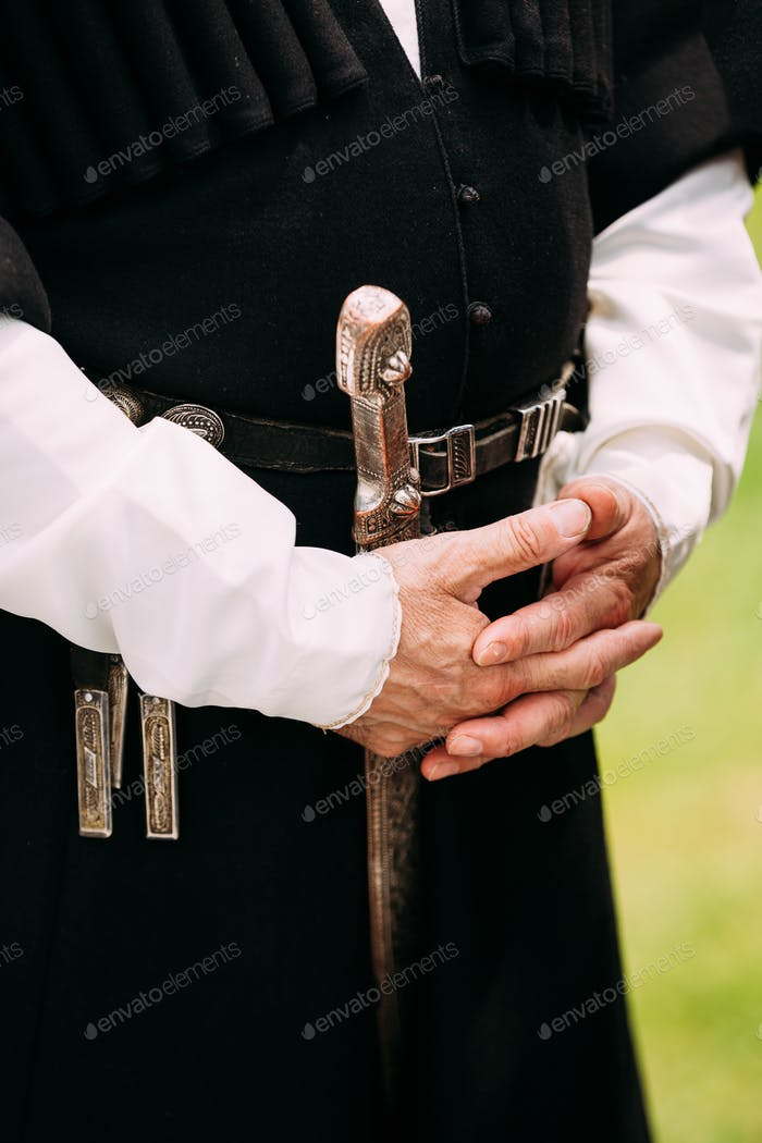 Close Up Hands Of Elder Georgian Man In National Clothes. Cultur