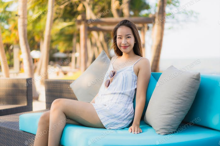 Portrait beautiful young asian woman happy smile relax around ne