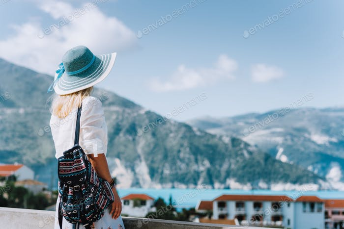 Female on holiday visiting greek Assos small town. Kefalonia, Greece. Sommer vacation vibes