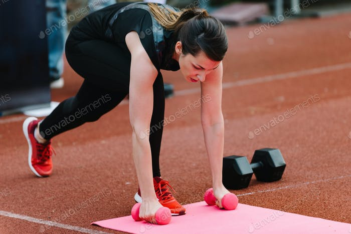 Young woman on competition outdoors