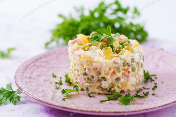 "Traditional Russian salad ""Olivier"". New Year salad. Festive salad."