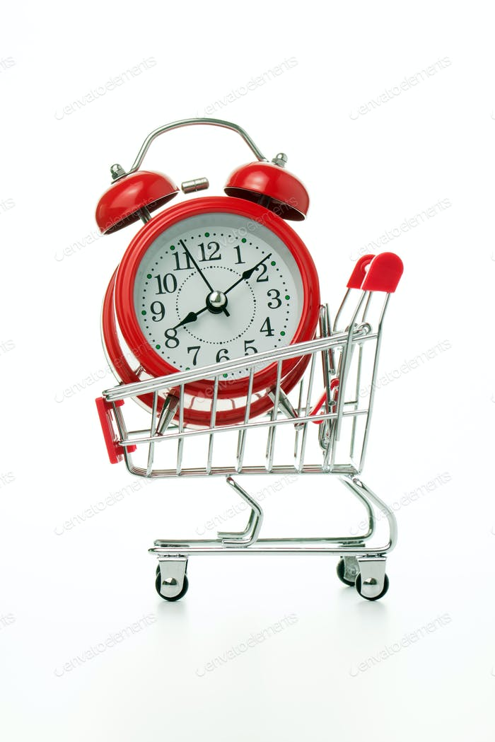 Red alarm clock in shopping cart