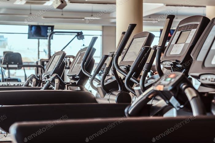 Photo of empty treadmills in gym