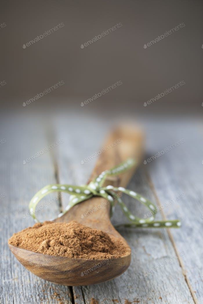 Cinnamon Powder in Wooden Spoon.
